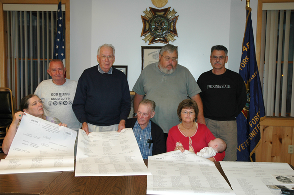 Company F Memorial Committee reviewing rosters in 2007: (seated L-R) Anne McElwee, Don Bensley and Kathy Iorio (standing L-R) Jim Freas, Bill Menz, Joe Franklin and Rich Glass.