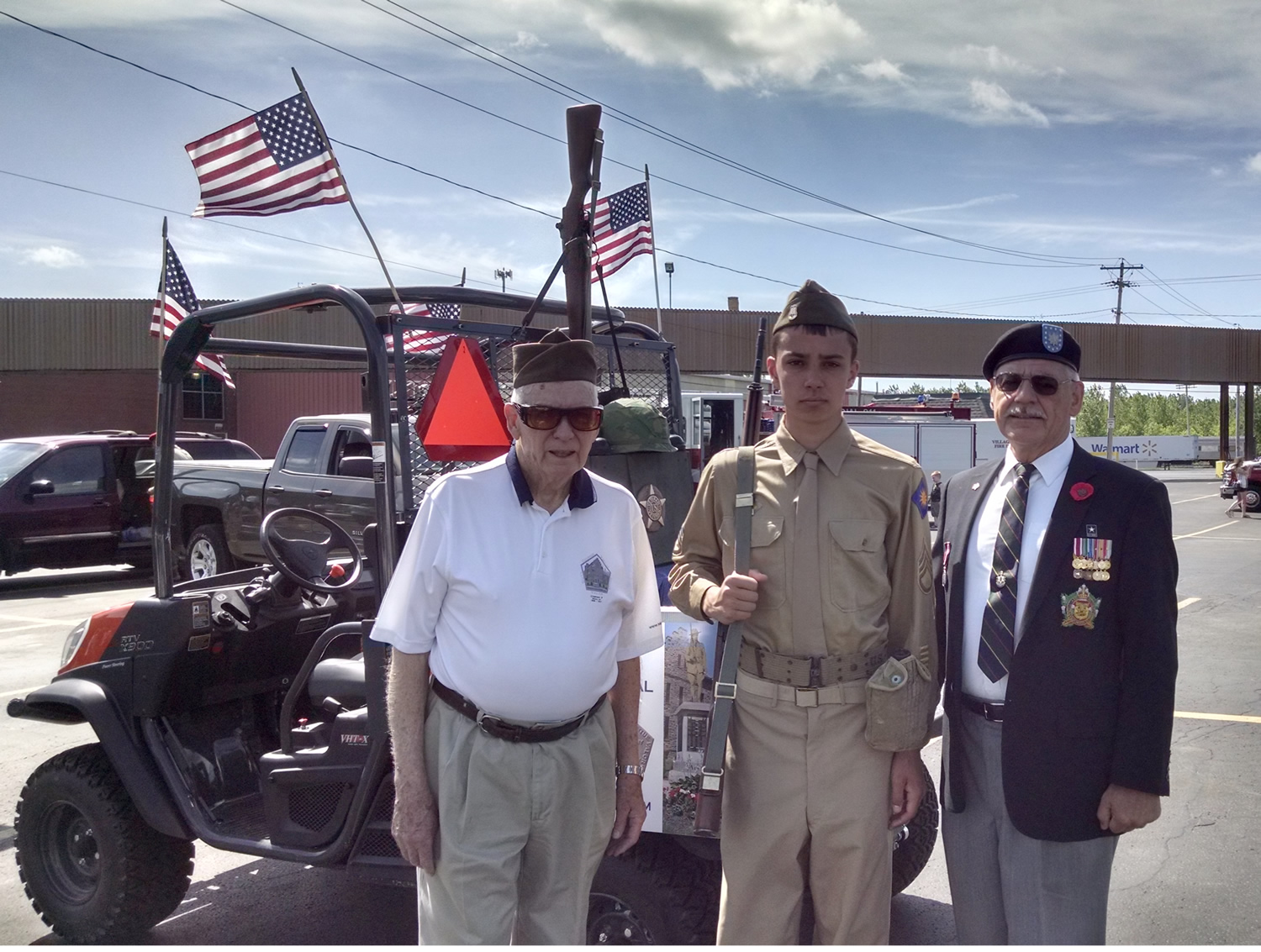 "Company F chairman, Bill Menz, ""model soldier"" Jack Hill and LtCol Richard Glass"
